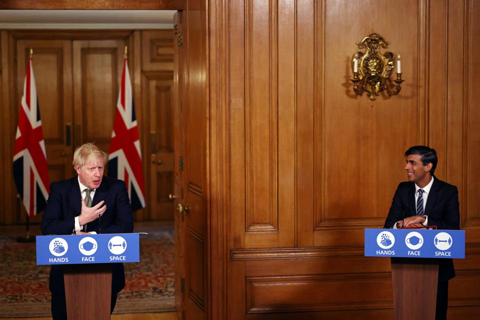 British Prime Minister Boris Johnson addresses the nation during a news conference at 10 Downing Street on October 22, 2020