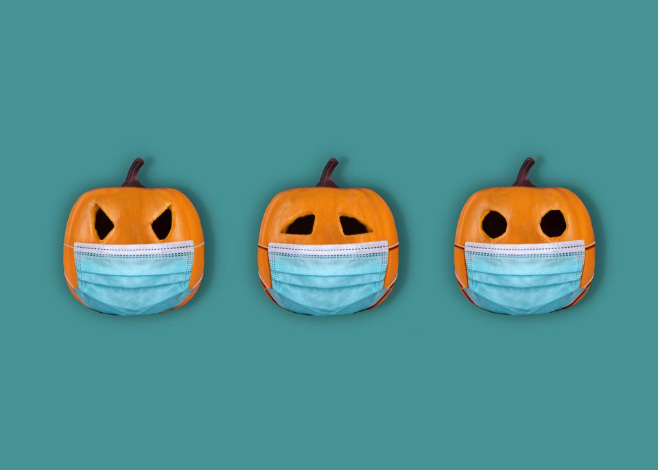 Halloween pumpkins with surgical mask