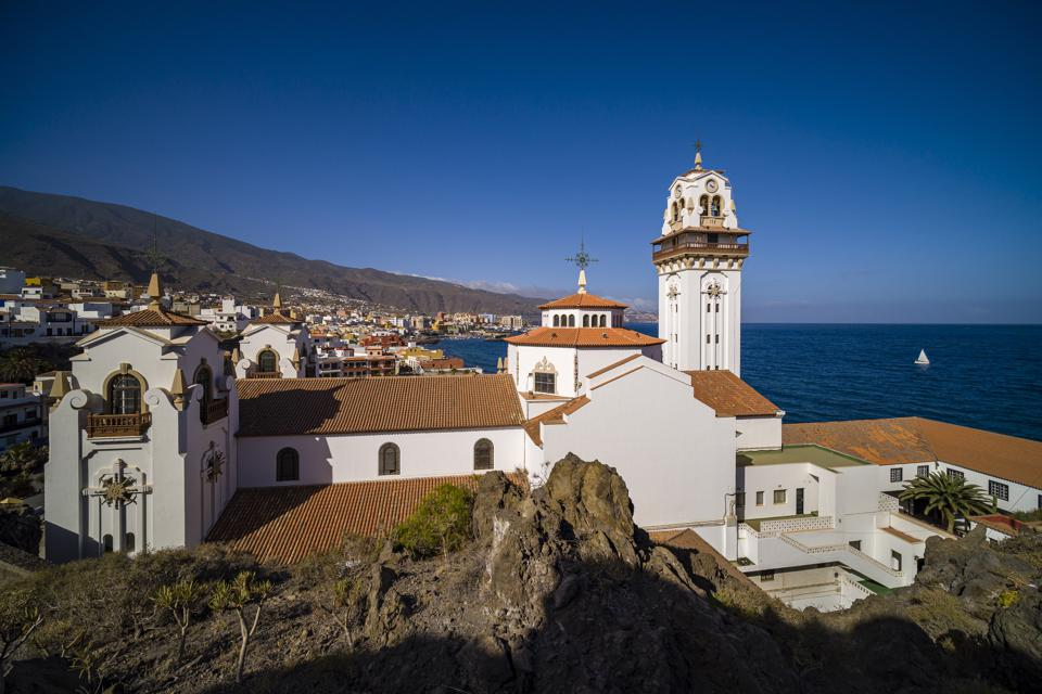 church and white buildings and sea
