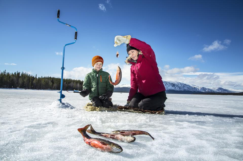 Mother with son ice fishing