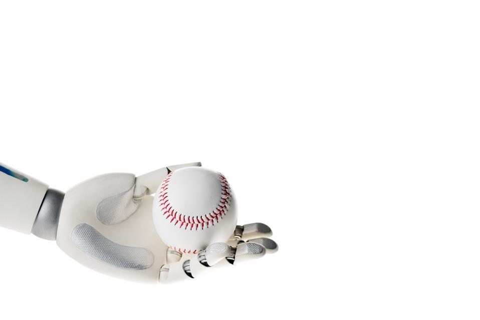 A robot hand holding a baseball.