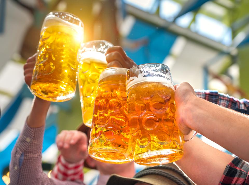 People toasting with beer glasses at Octoberfest in Munich