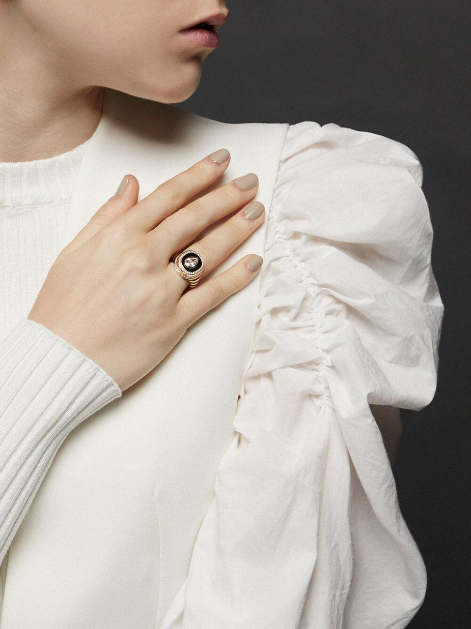 The Baret Signet Ring is a super-modern take on a classic shape. A pear-shaped diamond tops a beautiful, bold ring. Yellow gold and black enamel make for a bold, geographic statement. Destined to become a future heirloom.