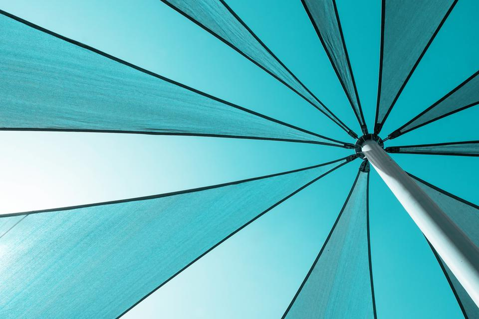 Fragment of sun umbrella. Abstract summer background