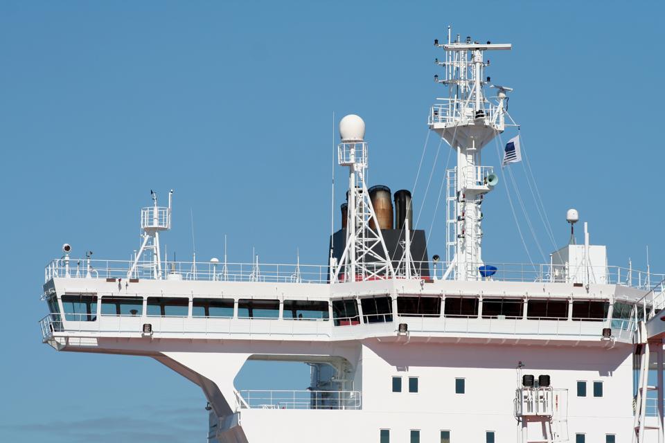 Ships bridge showing communication, meteorological and navigational sensors.