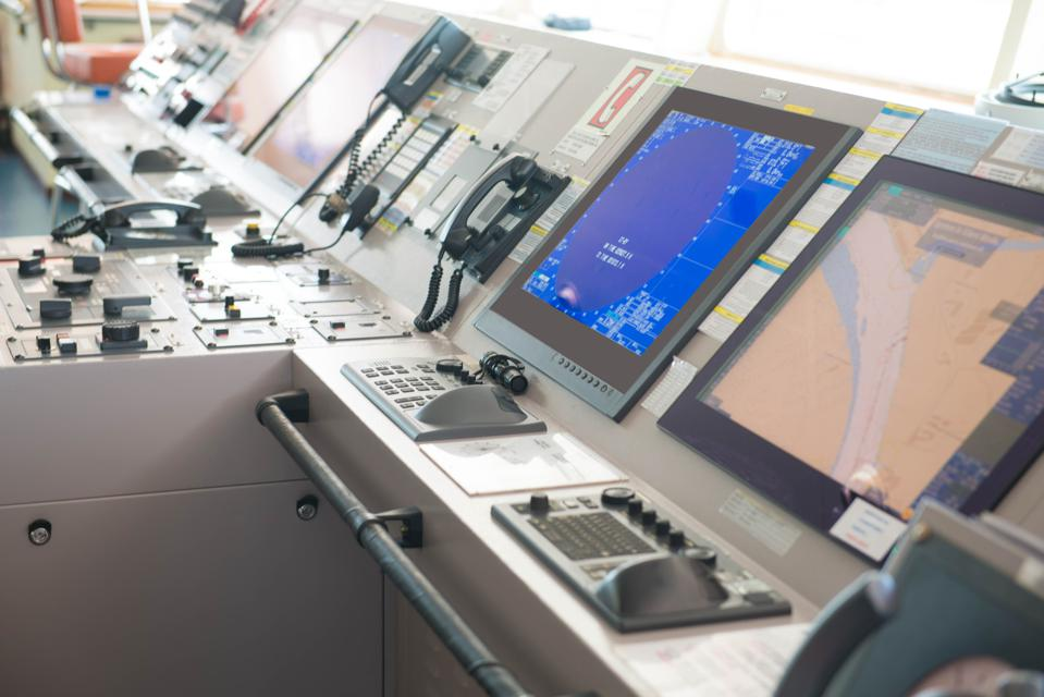 Bridge of a ship showing the Electronic Charts Display and Information System (ECDIS) and radar