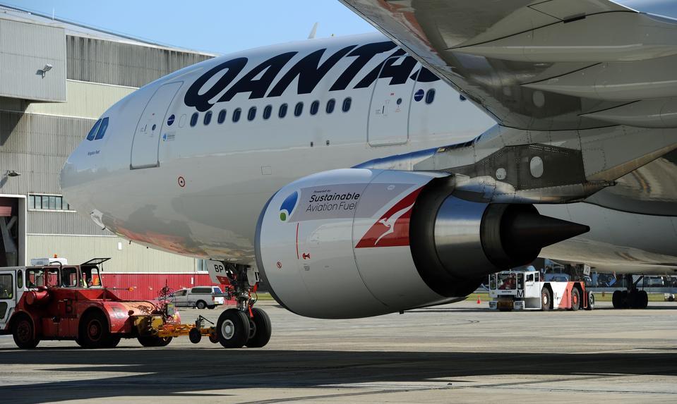 A Qantas A330, flight QF1121, moves to a