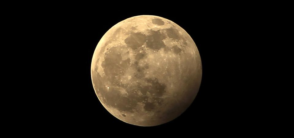 A full moon during a penumbral lunar eclipse.