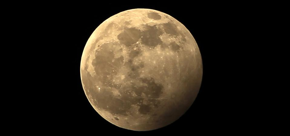 The full moon during a penumbral lunar eclipse.