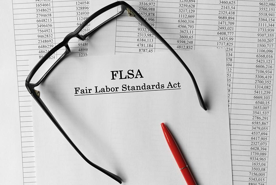 a piece of paper that reads fair labor standards act on a desk