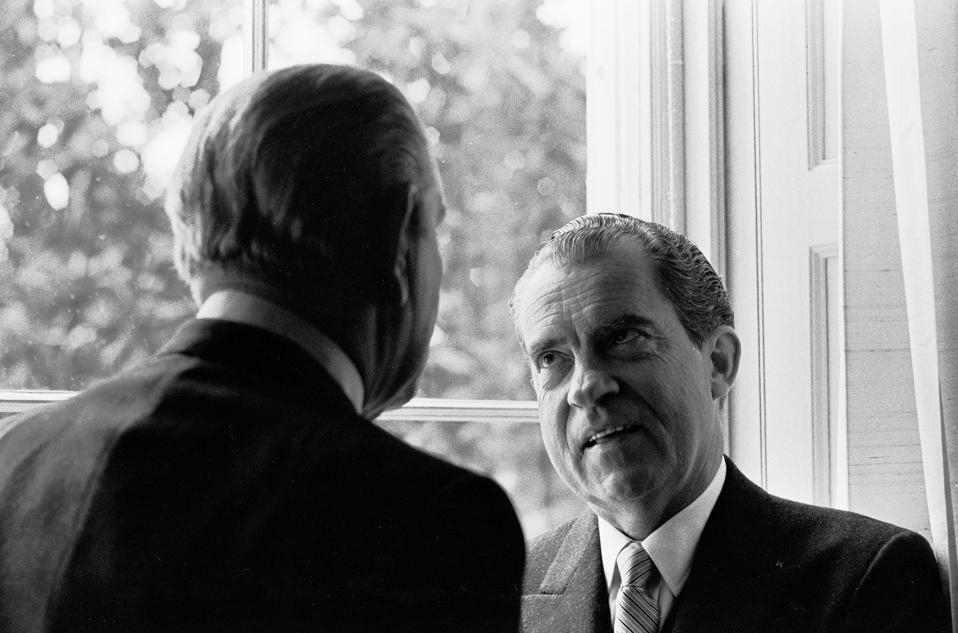 Lyndon Johnson and Richard Nixon confer on Inauguration Day, January 20, 1969.