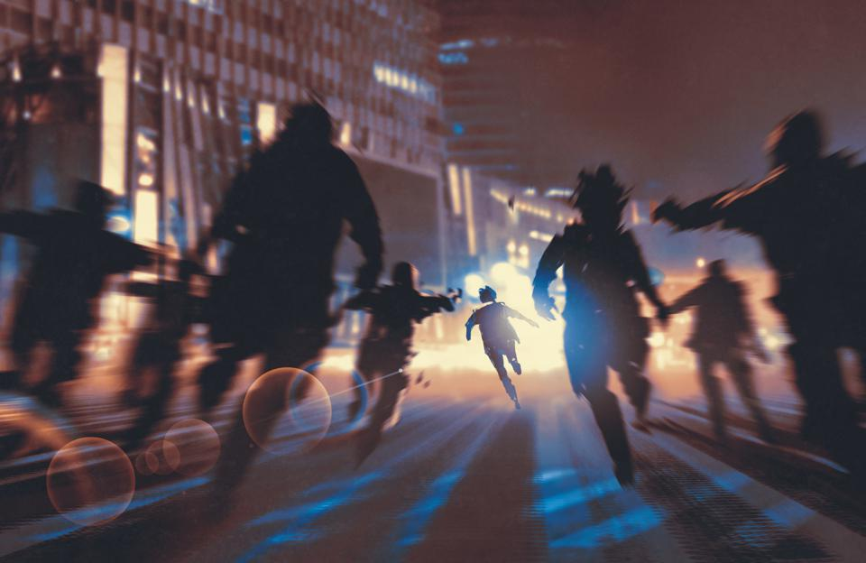 man running away from zombies in the night city