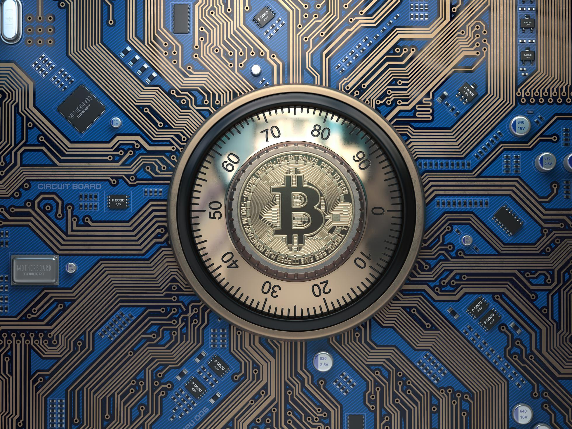 Bitcoin cryptocurrency security  and mining concept. Safe lock with symbol of bitcoin on circuit board.