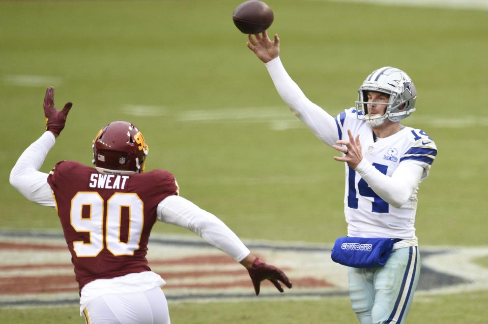 LANDOVER, MARYLAND - OCTOBER 25: Quarterback Andy Dalton #14 of the Dallas Cowboys throws a pass against Montez Sweat #90 of the Washington Football Team during the second quarter of the game at FedExField on October 25, 2020 in Landover, Maryland.