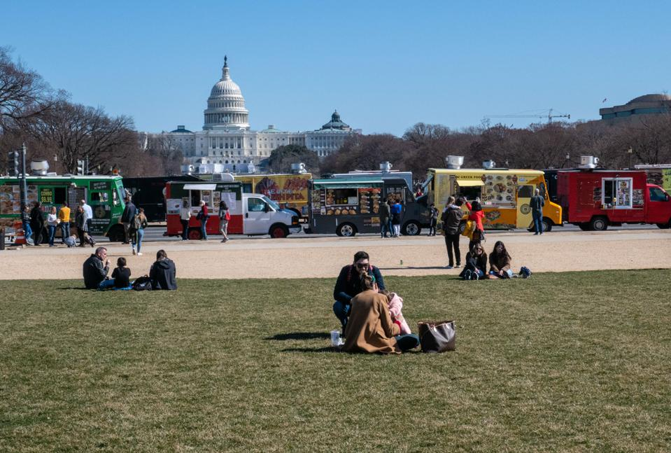 Food trucks line a street in front of the capitol building, Washington, D.C.