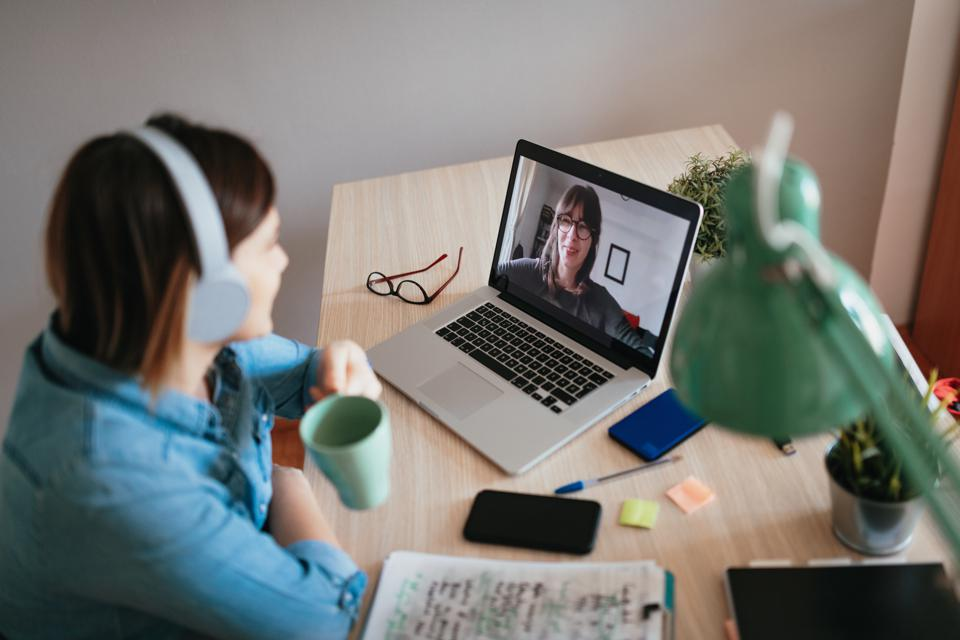 Business woman having online business meeting