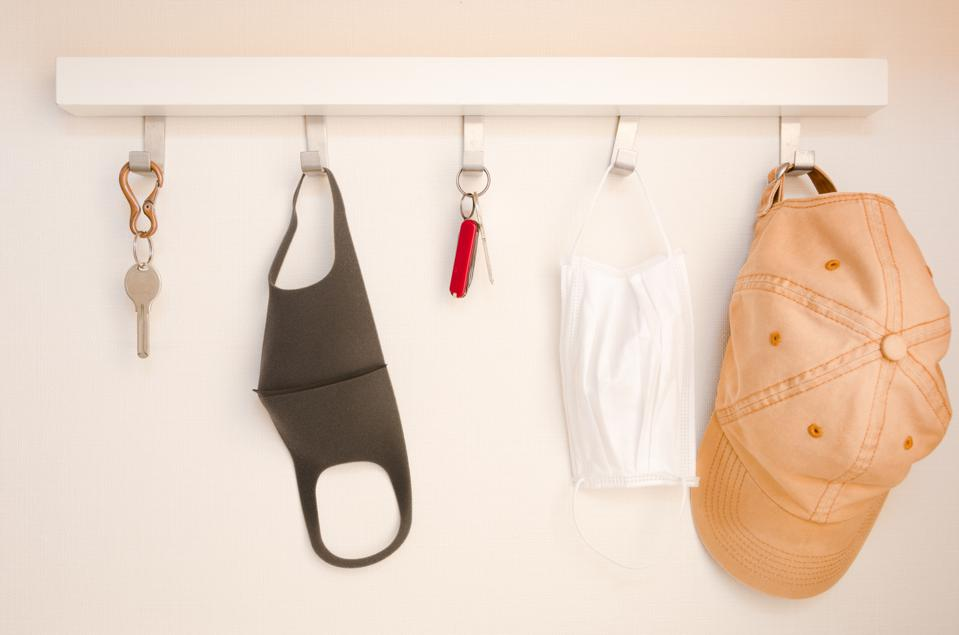 Hanger with keys, face masks and cap