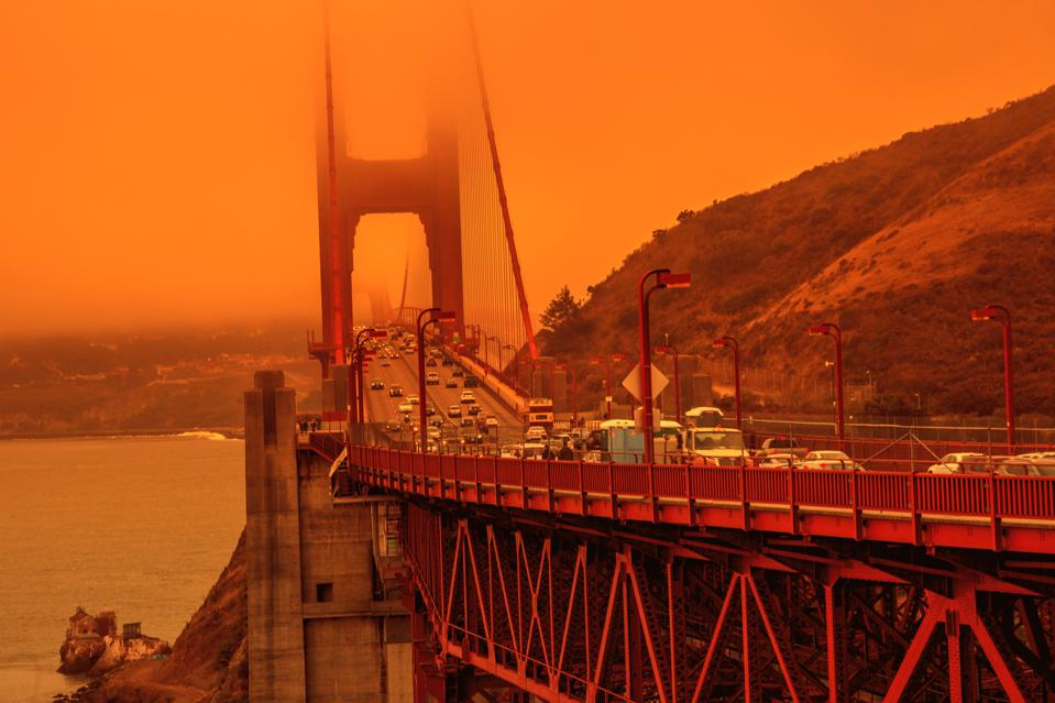 The Golden Gate Bridge with an orange sky caused by wildfires