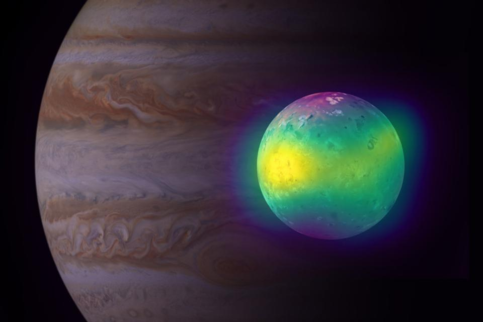 A composite image of the moon Io in front of its planet, Jupiter.