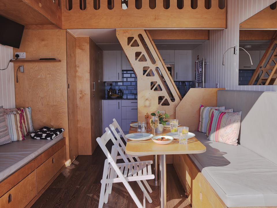 inside view of a beach lodge with chairs and table