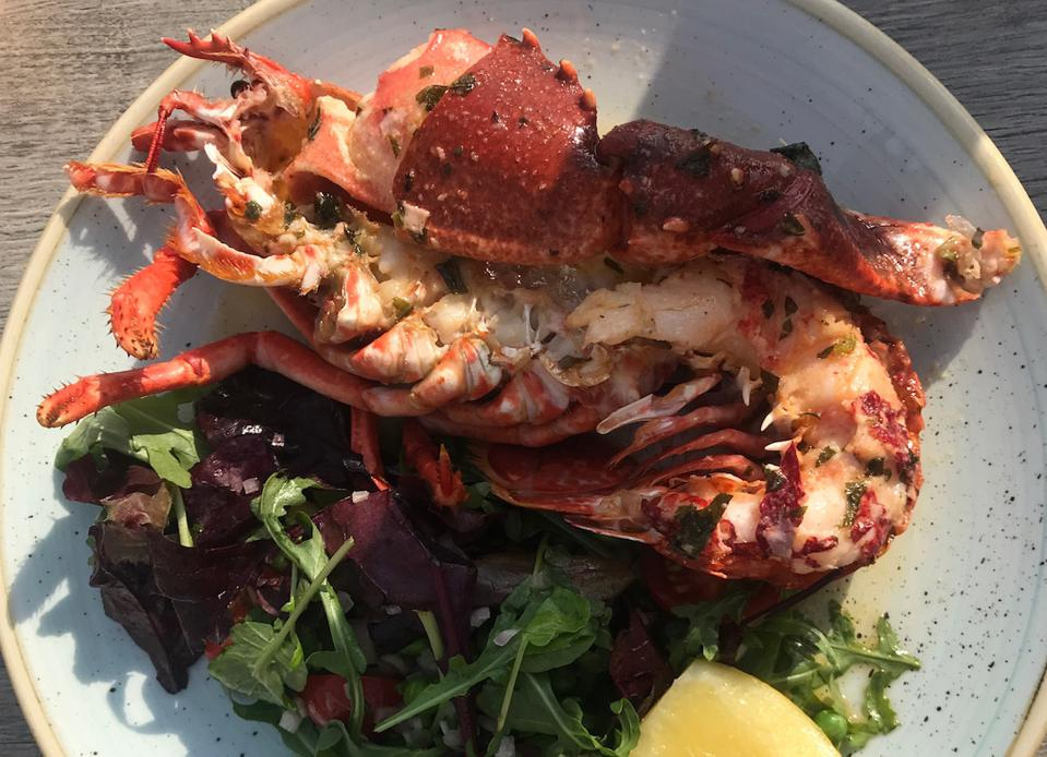 half lobster on a plate