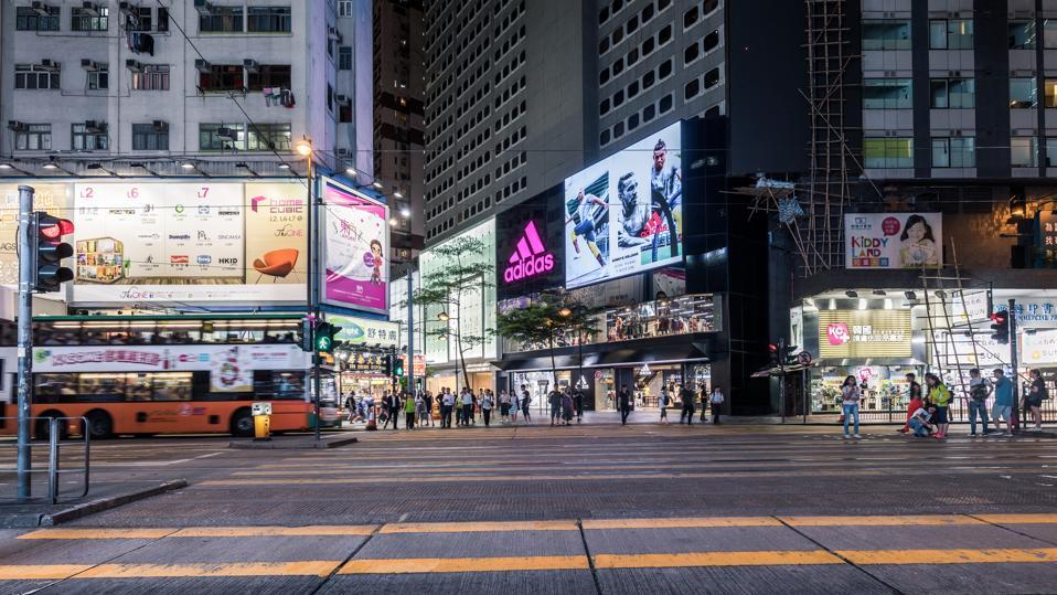 Crossroads in Hong Kong at night.