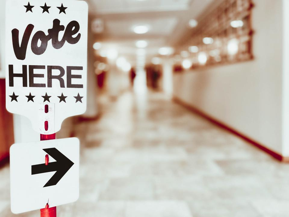 ″Vote Here″ Directional Sign at Polling Place