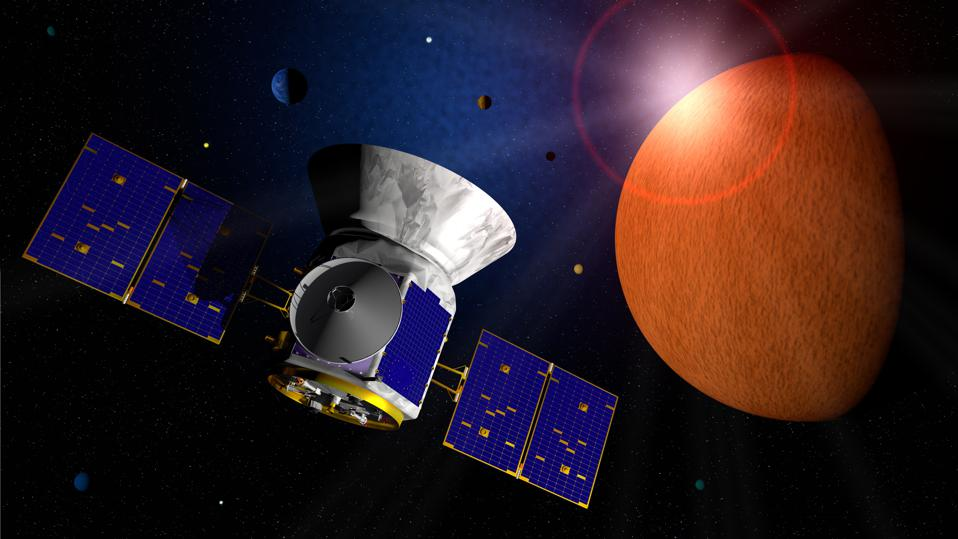 Transiting Exoplanet Survey Satellite TESS space telescope traveling through space in search of exo planets