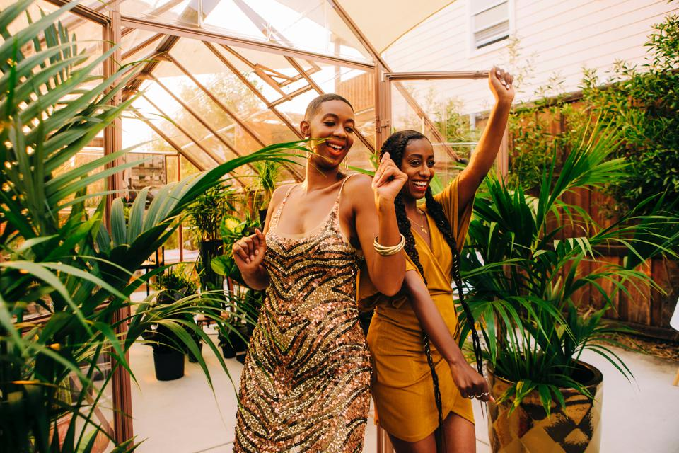 Blk Girls Greenhouse founders tk and tk celebrate their beautiful outdoor shopping space in Oakland, CA.