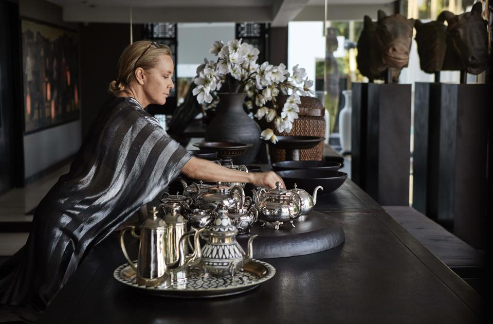 The designer with silver teapots from her Curated by MF home decor collection.