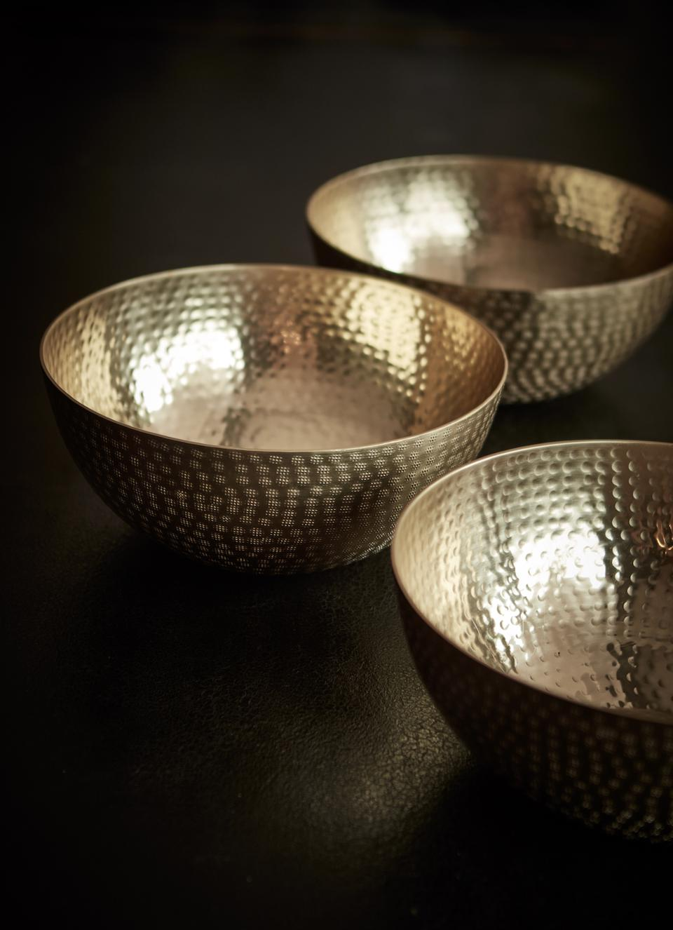 Bronze bowls with a unique handcrafted texture.