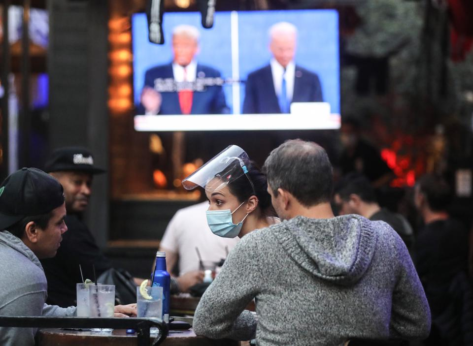 Americans Watch Final Presidential Debate Between Donald Trump And Joe Biden