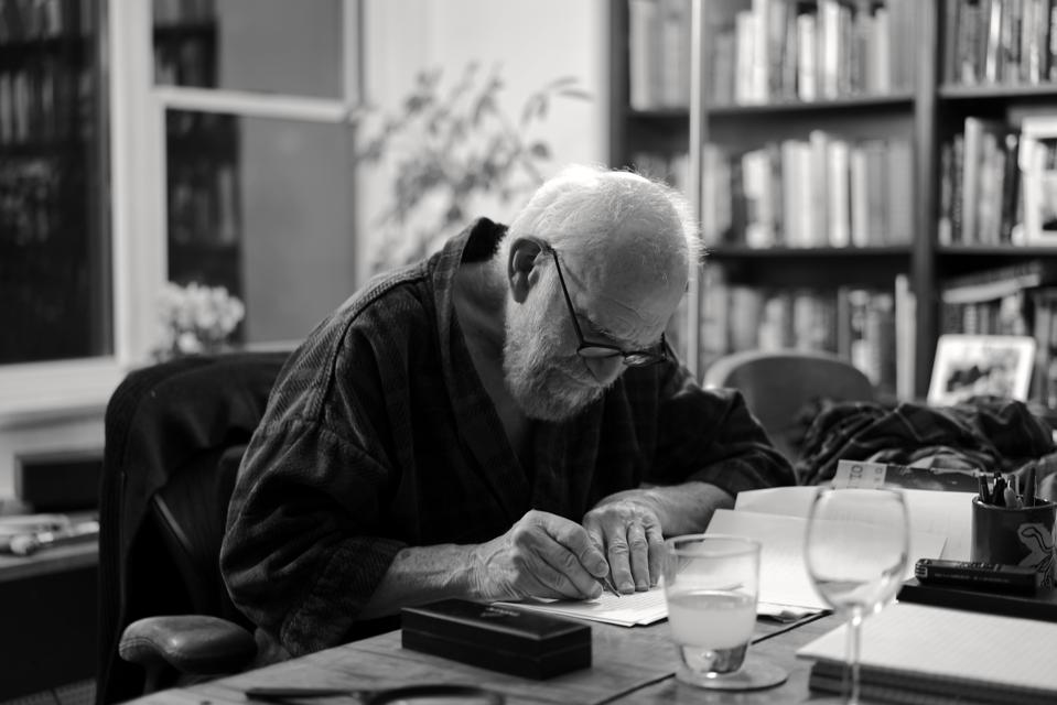 """An archival image of Oliver Sacks at home in 2015 seen in HHMI Tangled Bank Studios' film """"Oliver Sacks: His Own Life."""""""