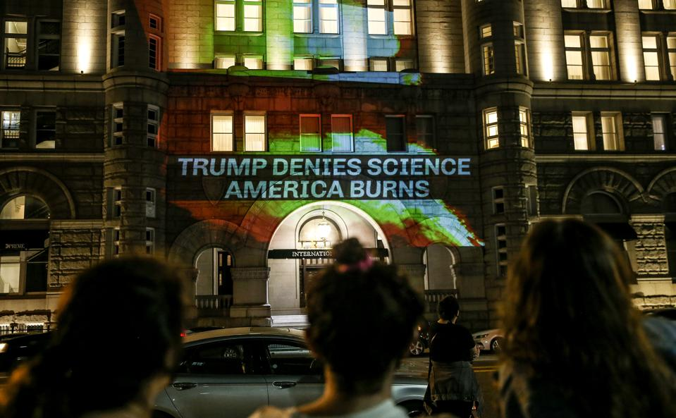 Activists Protest Trump's Response To Science And Climate Change As Wildfires Burn Across The Country
