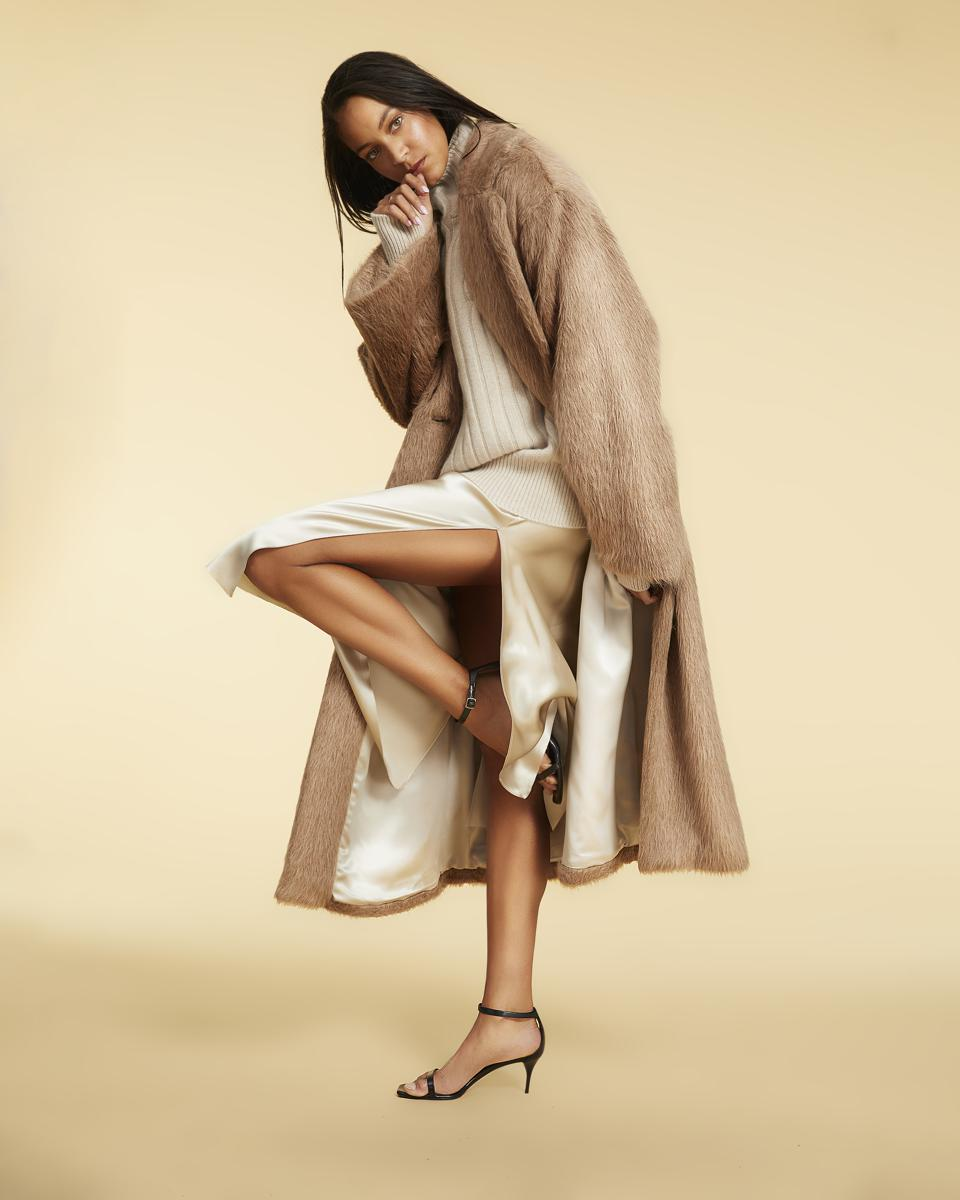A luxurious camel-hued alpaca coat, and cream-colored cashmere sweater and slip dress by Michelle Smith.