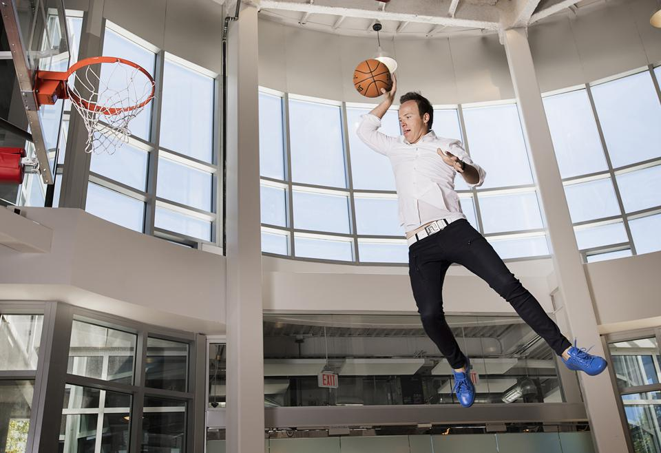 Qualtrics CEO Ryan Smith in his basement basketball court in his Provo, Utah home.