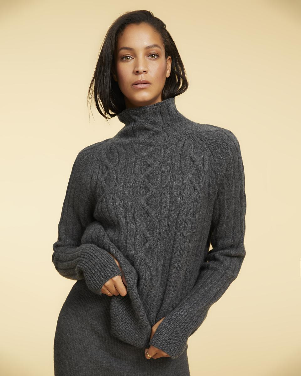 A gray mock-turtleneck cable stitch cashmere sweater looks substantial and luscious.
