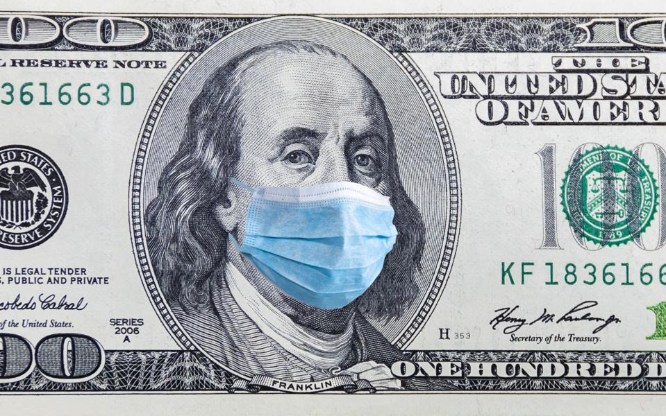 US quarantine and 100 dollar banknote with a medical mask.