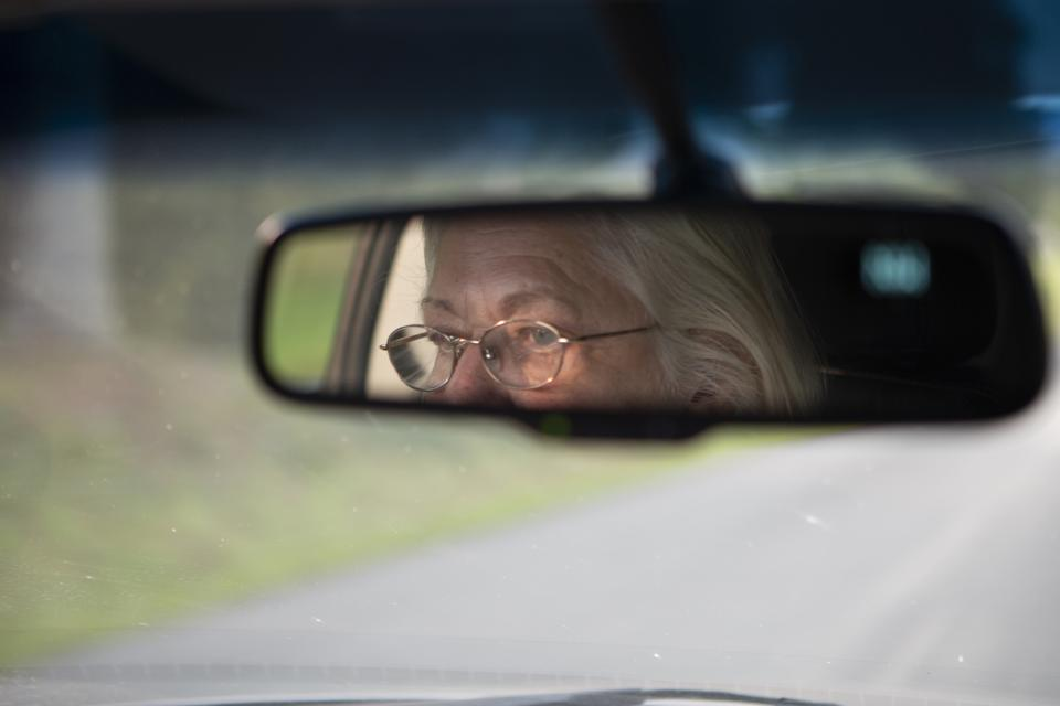 An older driver behind the wheel.