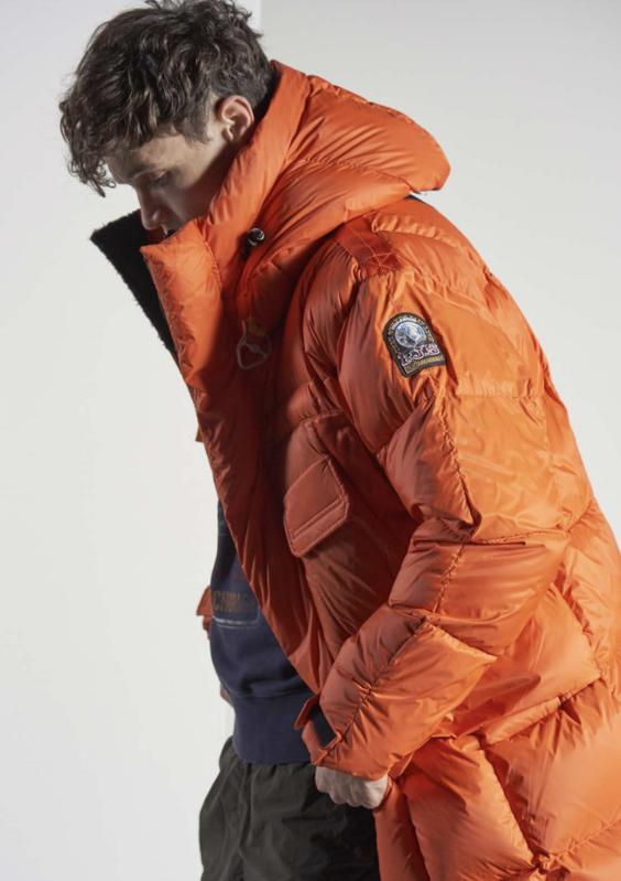 """The Bold Parka is the most wanted jacket of the new collection. It's a long puffer jacket, light on the skin but extremely warm, presented in sleek pencil black and in iconic Parajumpers orange."""""""