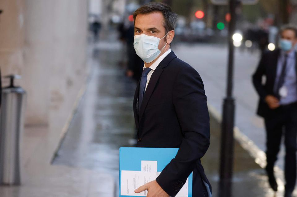 French Health Minister Olivier Véran arriving to decide tougher restrictions to counter an alarming surge in Covid-19 cases.