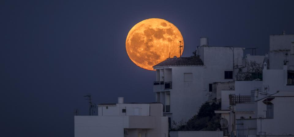 A full moon over Salobreña in Granada, Andalusia, Spain.