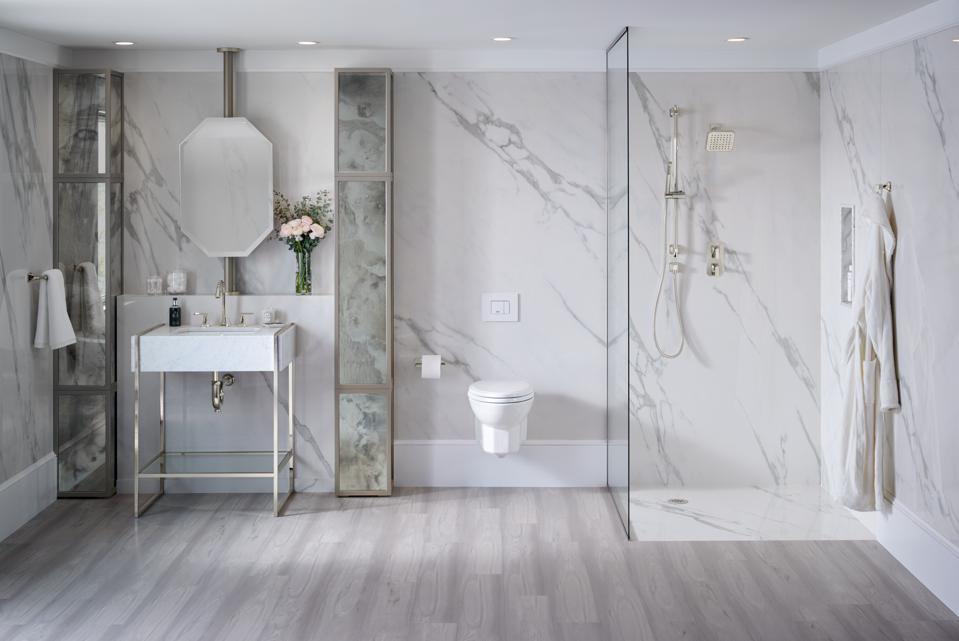 A bright bathroom with DXV fixtures.