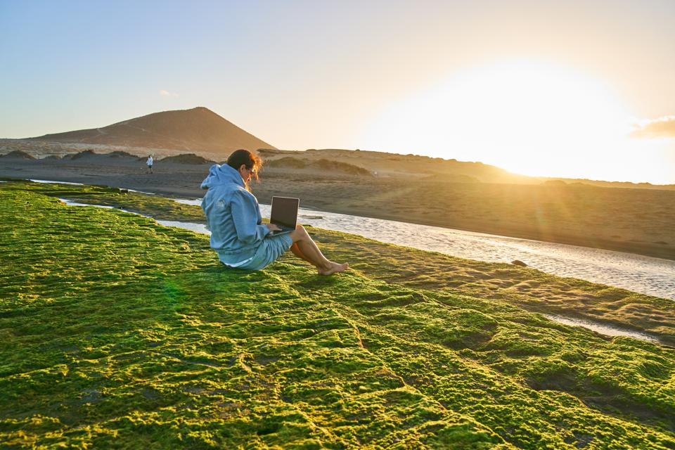 Digital nomads — employees or contractors who work remotely while traveling.