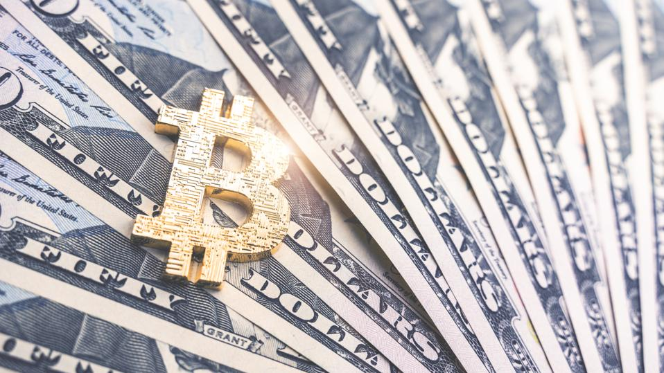 Physical version of Bitcoin and dollar banknotes. Exchange bitcoin for a dollar symbol. Conceptual image for worldwide cryptocurrency and digital payment system