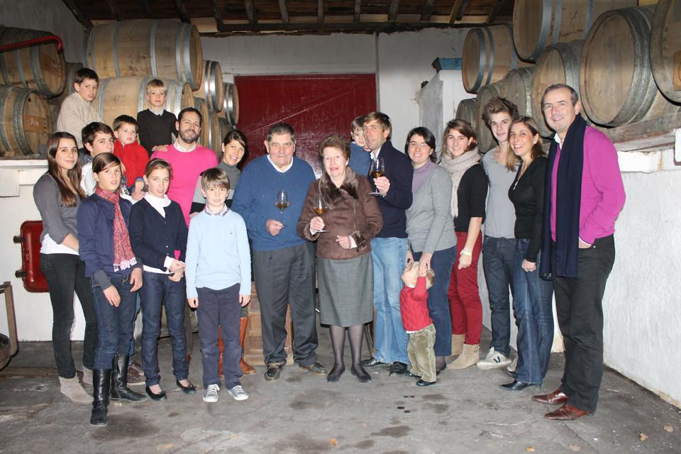 winemaking family in cellar, in France, Bordeaux