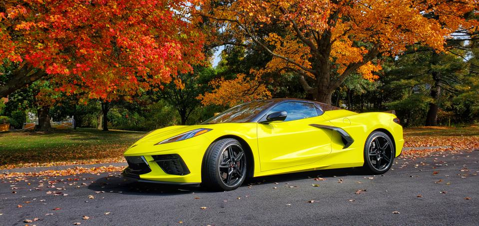 yellow 2020 Chevrolet Corvette Stingray convertible with vibrant fall foliage