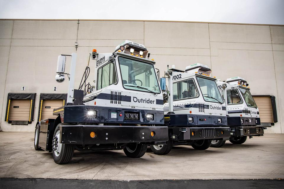 Multiple Outrider autonomous vehicles work in concert to perform the tasks in distribution center yards.