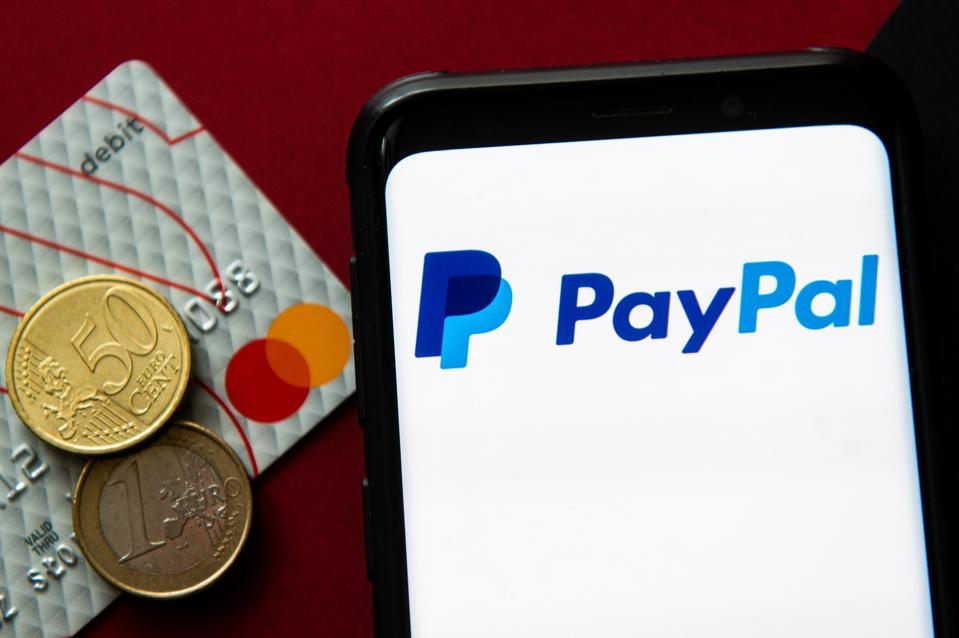 In this photo illustration a PayPal logo seen displayed on a...