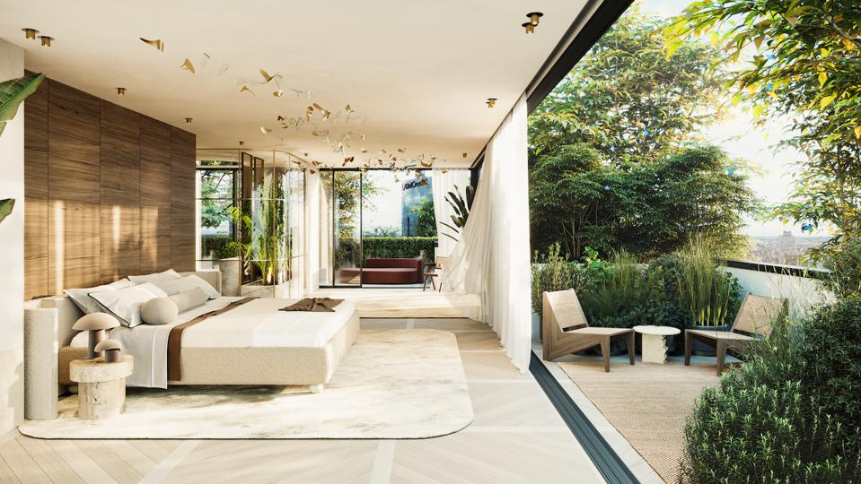 The penthouse flat has glass walls on all sides that open onto plant-filled terraces
